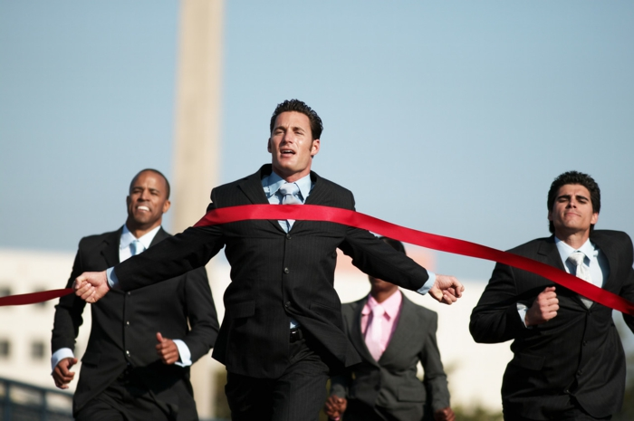 Businesspeople Running Towards Finish Line --- Image by © Royalty-Free/Corbis
