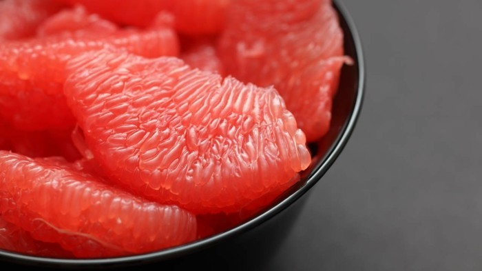 Red Grapefruit in a black bowl