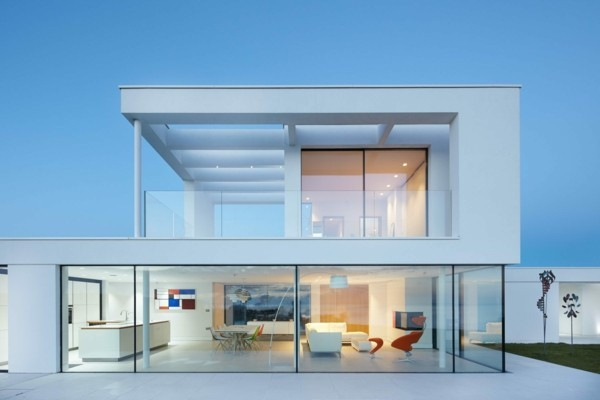 Skyframe sliding doors with structural frameless glass.